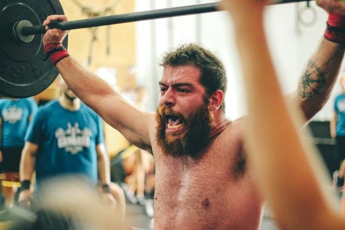 behind-neck-press-useless-exercises-organixmag